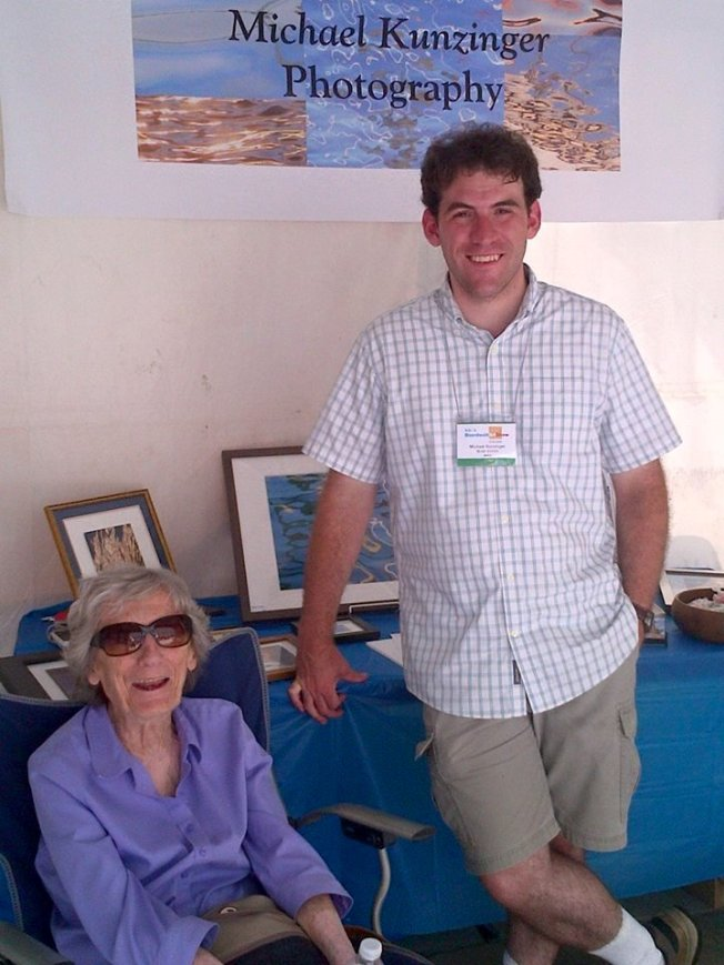 with Grandma at his booth in the Boardwalk Art Show