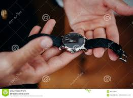 Man Holding A Watch In The Hands Before To Put It On. Stock Image - Image  of black, human: 99245885